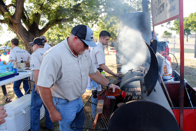 Employees cooking food for a cookout