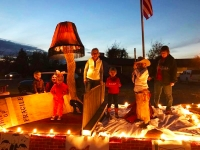 Adults and kids on a Christmas Story parade float in Quanah