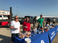 Employees serving food at a cook out
