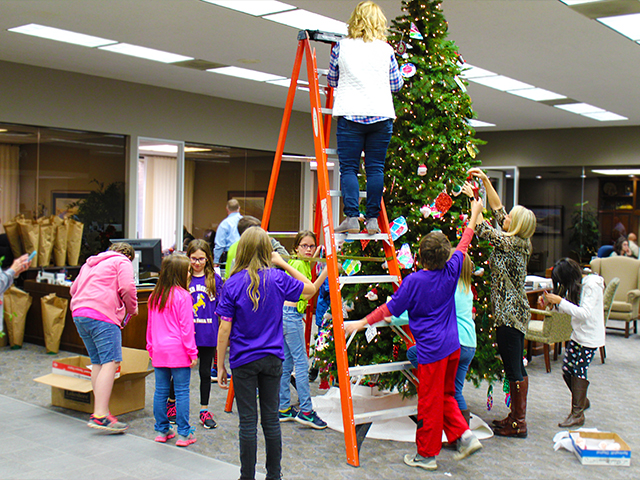 Group of students from Fowler Elementary decorating Christmas Tree.