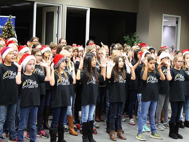 Group of children singing with arms up from Fowler Elementary.