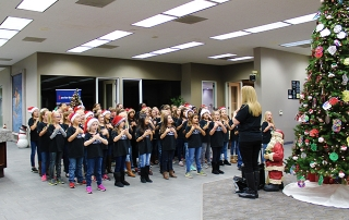 Group of children singing with arms crossed from Fowler Elementary.