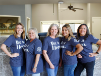 Downtown Branch employees smiling while wearing Be a Hero shirts.