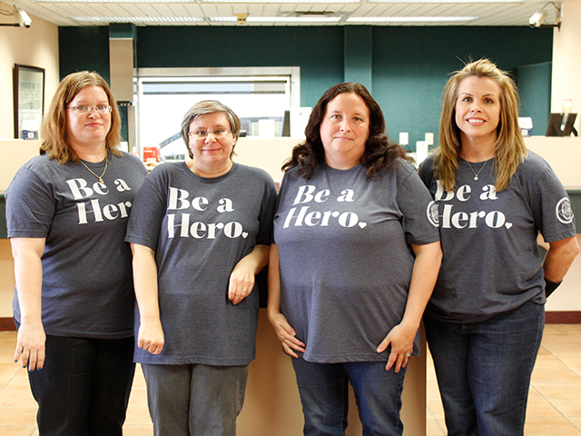 Iowa Park Branch employees smiling while wearing Be a Hero shirts.