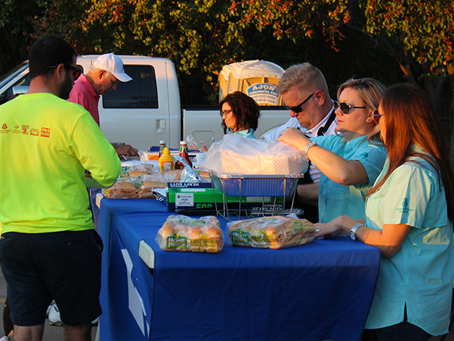 Employees working a cookout during a charity event.