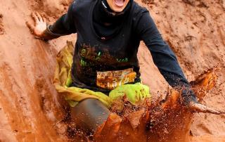 Meagan Swenson sliding into a mud pit.