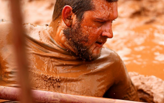 Curt Knobloch getting out of a mud pit.